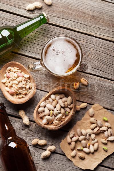 Alman birası bira fındık ahşap masa üst görmek Stok fotoğraf © karandaev