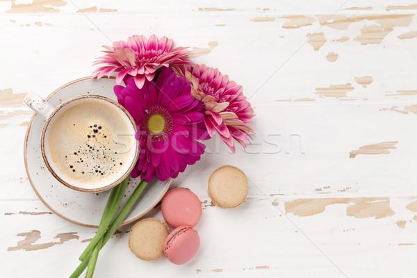 Coffee cup and gerbera flowers Stock photo © karandaev