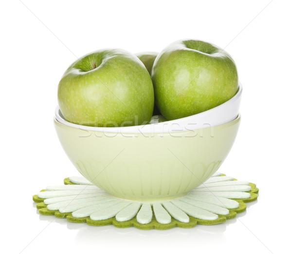 Green apples in fruit bowl Stock photo © karandaev