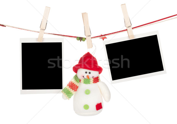 Two blank photos and snowman hanging on the clothesline Stock photo © karandaev