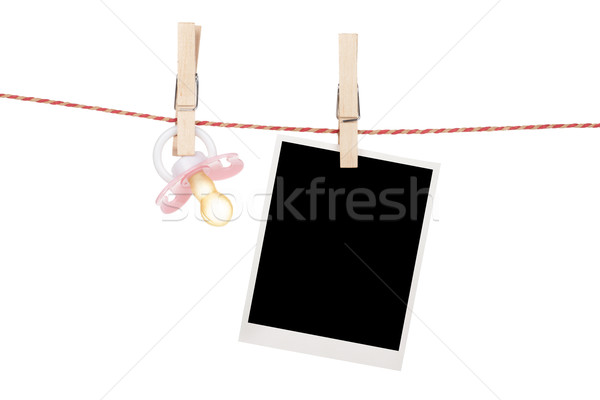 Instant photo and pacifier hanging on the clothesline Stock photo © karandaev