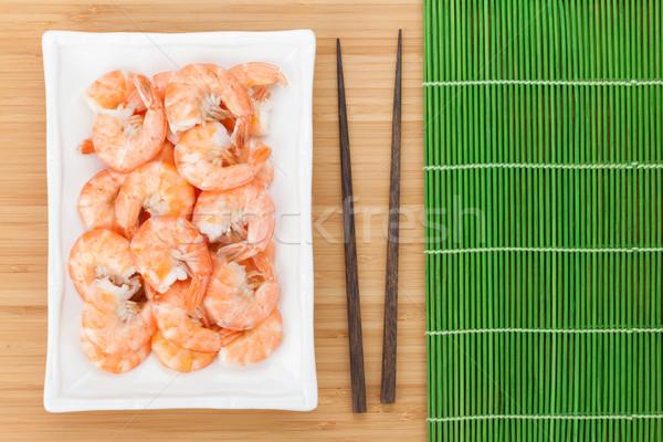 Pişmiş Çin yemek çubukları ahşap masa arka plan kırmızı Stok fotoğraf © karandaev
