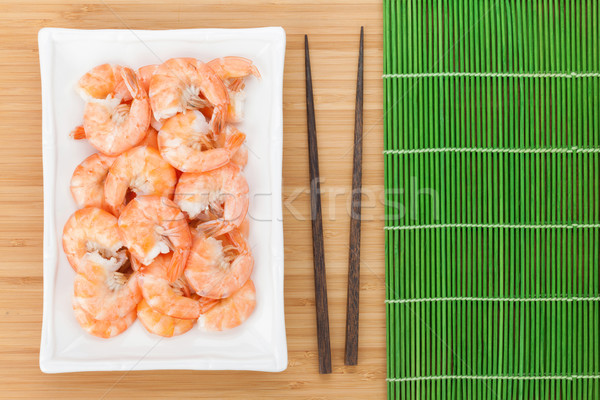Cocido palillos mesa de madera fondo rojo Foto stock © karandaev