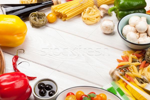 Italian food cooking ingredients. Pasta, vegetables, spices Stock photo © karandaev