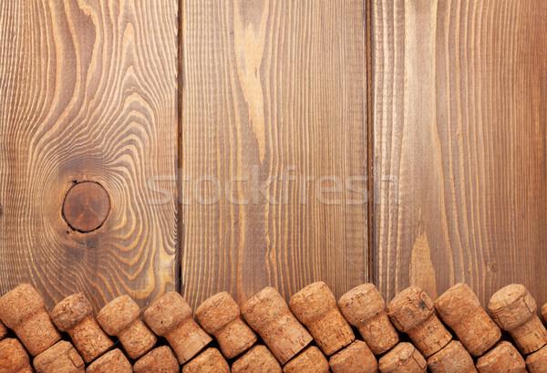 Champagne wine corks over wooden table Stock photo © karandaev