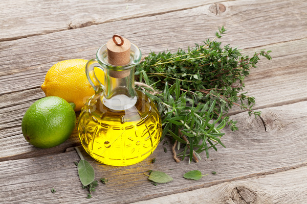 Stock photo: Olive oil and fresh garden herbs