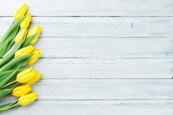 Easter card wooden background with yellow tulips Stock photo © karandaev