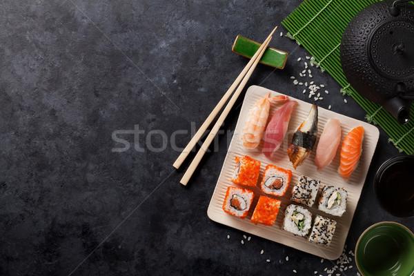 Conjunto sushi maki rolar chá verde pedra Foto stock © karandaev