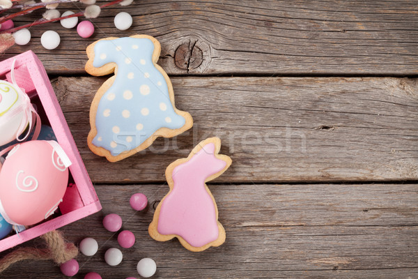 Húsvét mézeskalács sütik tojások fa asztal színes Stock fotó © karandaev