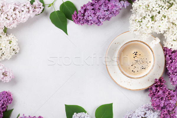 Colorful lilac flowers and coffee cup Stock photo © karandaev
