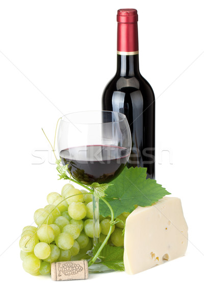 Stock photo: Red wine glass, bottle, cheese and grapes
