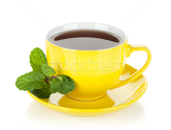 Yellow tea cup with mint Stock photo © karandaev