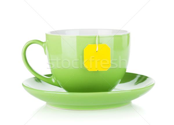 Green tea cup and teabag Stock photo © karandaev