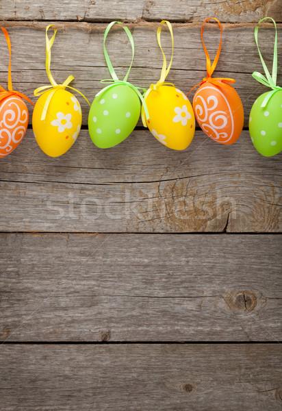 Húsvéti tojások fa asztal fészek tányér fából készült copy space Stock fotó © karandaev