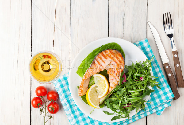 Stock photo: Grilled salmon and whtie wine on wooden table