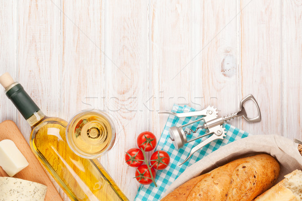 White wine, cheese and bread on white wooden table background Stock photo © karandaev