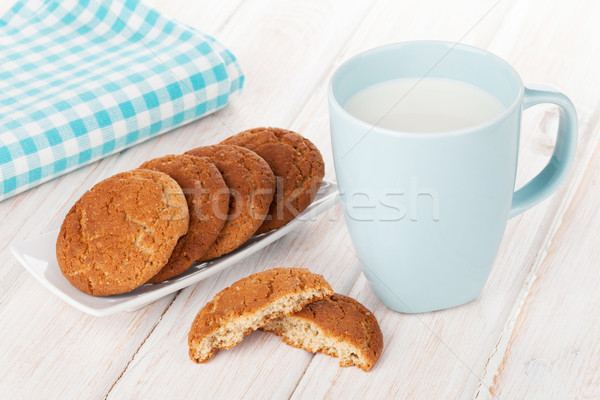 Stock photo: Cup of milk and gingerbread cookies