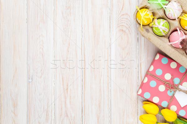 Húsvét citromsárga tulipánok színes tojások fehér Stock fotó © karandaev