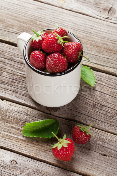 Fresh garden strawberry in cup Stock photo © karandaev