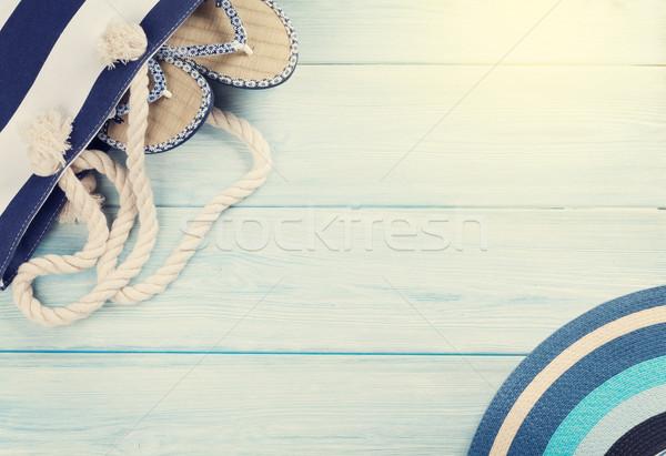 Beach accessories on wooden background Stock photo © karandaev