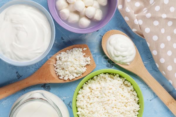 Tejtermékek kő asztal tejföl tej sajt Stock fotó © karandaev
