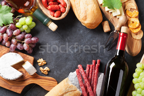 Red and white wine, grape, cheese and sausages Stock photo © karandaev