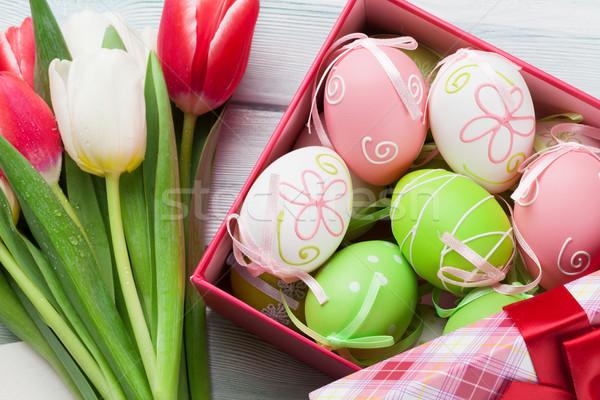 Easter eggs and tulips bouquet Stock photo © karandaev
