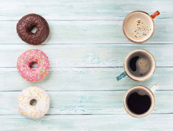 Coffee cup and colorful donuts Stock photo © karandaev