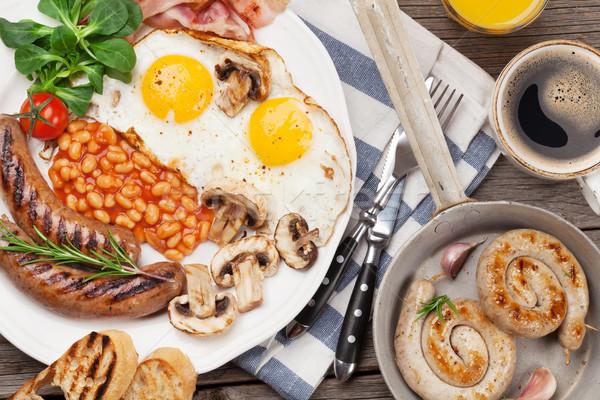 English breakfast. Fried eggs, sausages, bacon Stock photo © karandaev
