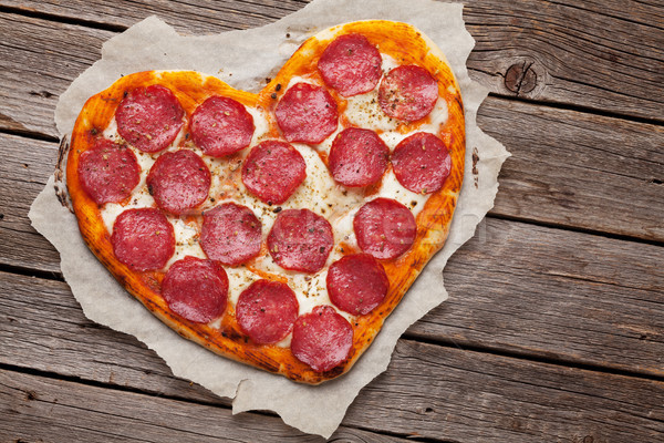 Corazón pizza pepperoni día de san valentín tarjeta de felicitación Foto stock © karandaev