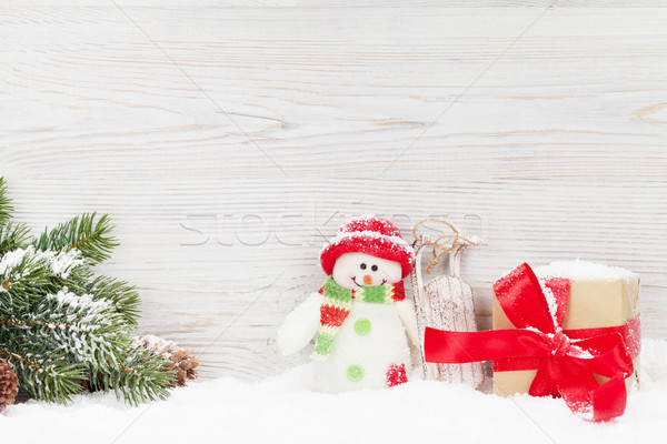 Christmas gift box, snowman toy and fir tree branch Stock photo © karandaev