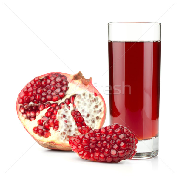 Pomegranate juice in a glass and ripe pomegranate Stock photo © karandaev