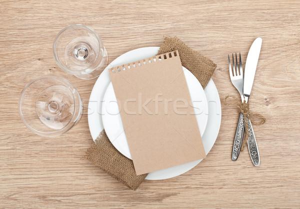 чистый лист бумаги пластина Бокалы столовое серебро набор деревянный стол Сток-фото © karandaev