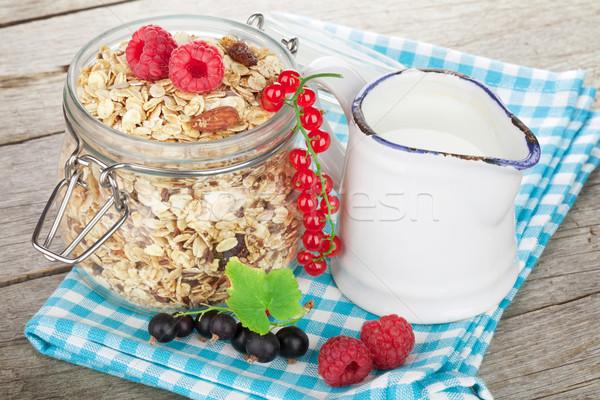 Reggeli müzli bogyók tej fa asztal fa Stock fotó © karandaev