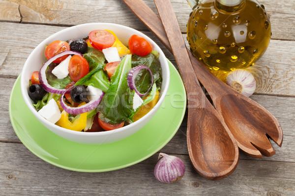 Fresh healty salad and kitchen utensils Stock photo © karandaev
