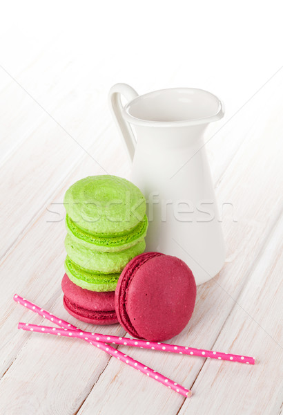 Colorful macarons and milk jug Stock photo © karandaev