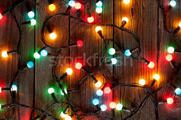 Christmas kolorowy światła drewniany stół drewna szczęśliwy Zdjęcia stock © karandaev