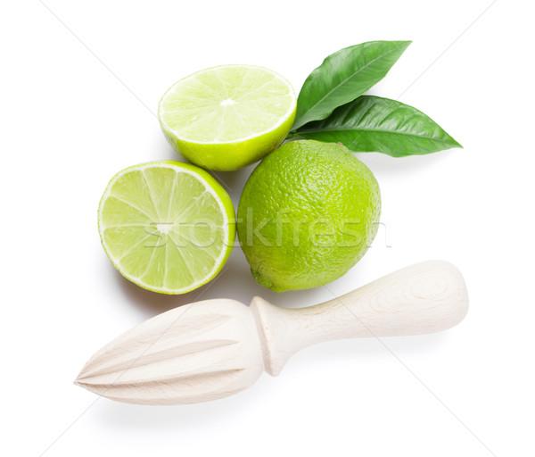 Fresh ripe limes and juicer Stock photo © karandaev