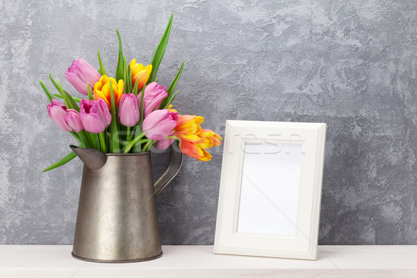 Fresh colorful tulips bouquet and photo frame Stock photo © karandaev
