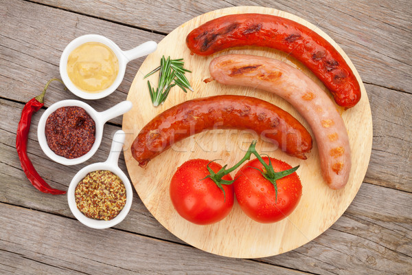 Stock photo: Various grilled sausages with condiments and tomatoes