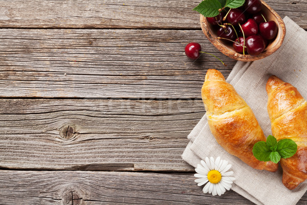 Croissants, cherry and chamomile Stock photo © karandaev