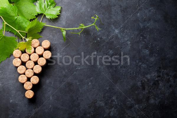 Wine corks grape shape and vine Stock photo © karandaev