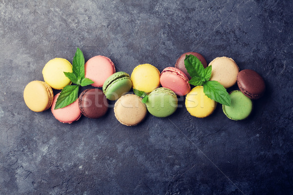 Colorful macaroons on stone table. Sweet macarons Stock photo © karandaev