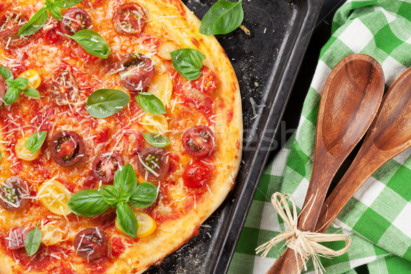 Pizza with tomatoes, mozzarella and basil Stock photo © karandaev