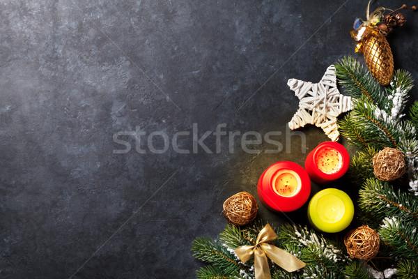 Karácsony gyertyák hó fenyőfa kő asztal Stock fotó © karandaev