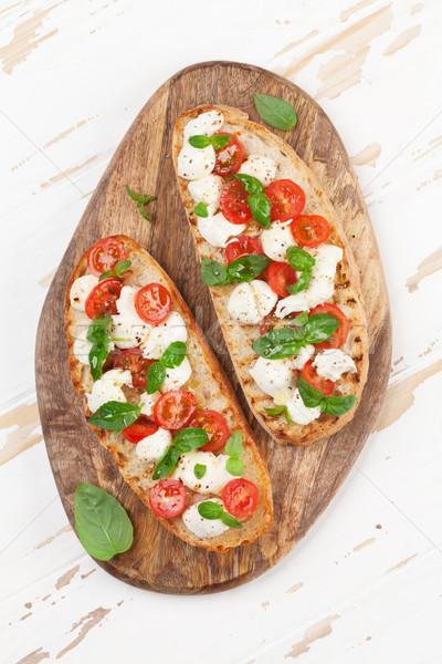 Caprese bruschetta mozzarella tomates cherry frescos jardín Foto stock © karandaev