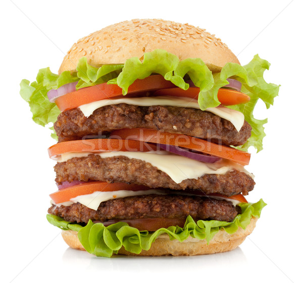 Large burger with beef, cheese, onion and tomatoes Stock photo © karandaev