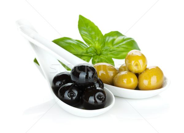 Verde aceitunas negras albahaca alimentos fondo petróleo Foto stock © karandaev