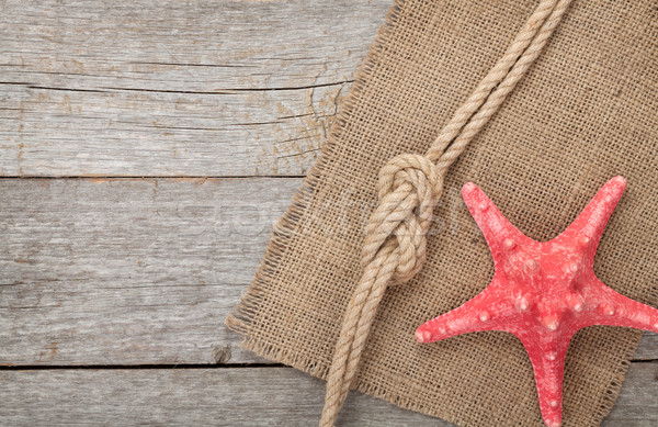 Starfish with ship rope and burlap Stock photo © karandaev