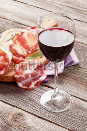 Red wine glass and grilled beef steak Stock photo © karandaev